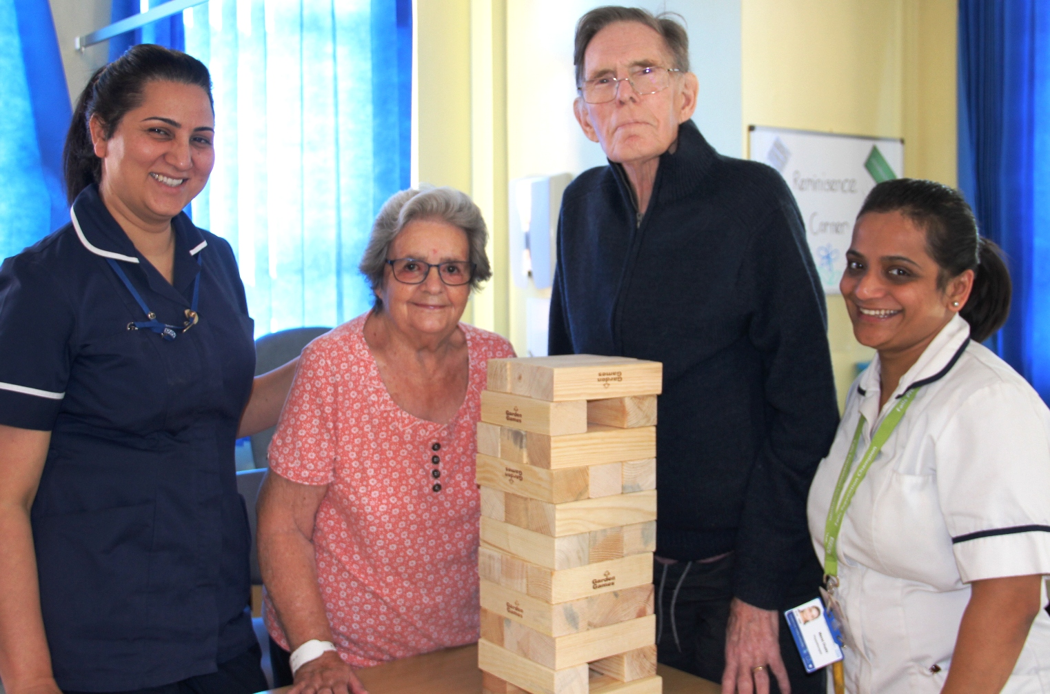 In the pictures: Ward Sister Kiran Dhillon, patients Eunice Webb and David Emmett and Physiotherapist Mansi Gupta playing Jenga.